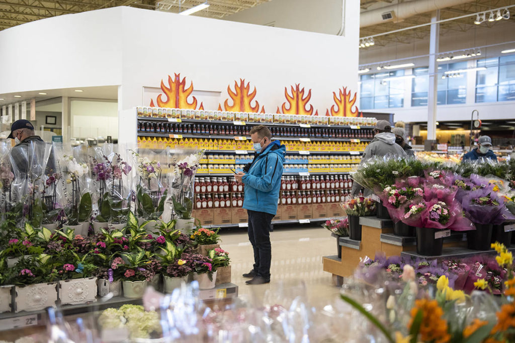People wait to be seen by the pharmacist who will deliver their first COVID-19 vaccine in a Loblaws grocery store pharmacy in Ottawa, on Monday, April 26, 2021. THE CANADIAN PRESS/Justin Tang