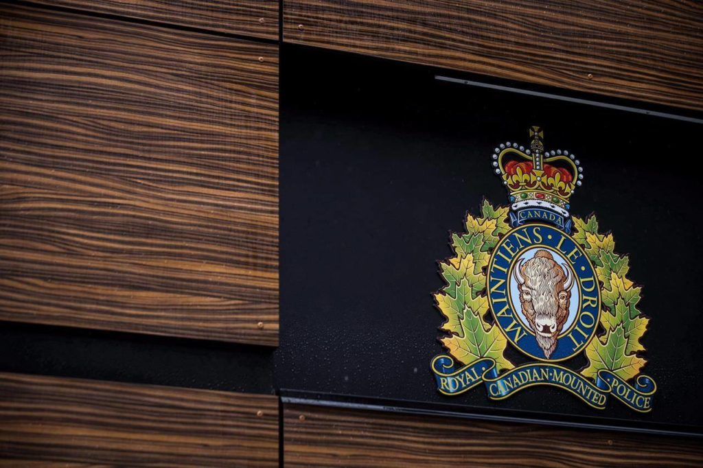 """The RCMP logo is seen outside Royal Canadian Mounted Police """"E"""" Division Headquarters, in Surrey, B.C., on April 13, 2018. A Canadian man is awaiting his next court date from across the border after he was detained by American authorities for allegedly trying to enter the U.S. in a kayak. THE CANADIAN PRESS/Darryl Dyck"""