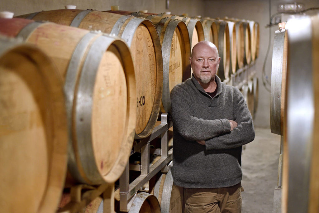 Bailey Williamson, winemaker, with wine barrels at Blue Grouse Estate Winery. Don Denton photo