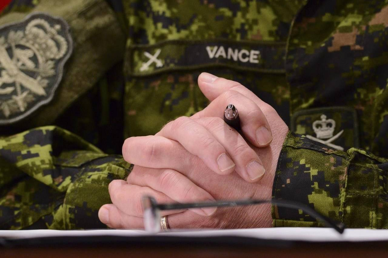 """Chief of Defence Staff Jonathan Vance takes part in a press conference on Parliament Hill during the COVID-19 pandemic in Ottawa on Thursday, April 30, 2020. Prime Minister Justin Trudeau says nobody in his office knew an allegation against Canada's top military officer three years ago was a """"Me Too complaint."""" THE CANADIAN PRESS/Sean Kilpatrick"""