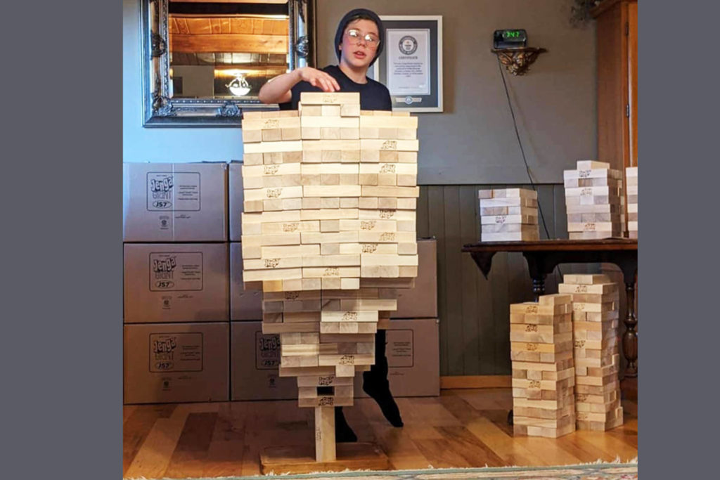 In addition to breaking his own world record for stacking normal-sized Jenga blocks, Auldin Maxwell also earned a world record for stacking giant Jenga blocks, 500 on one vertical block. (Contributed)