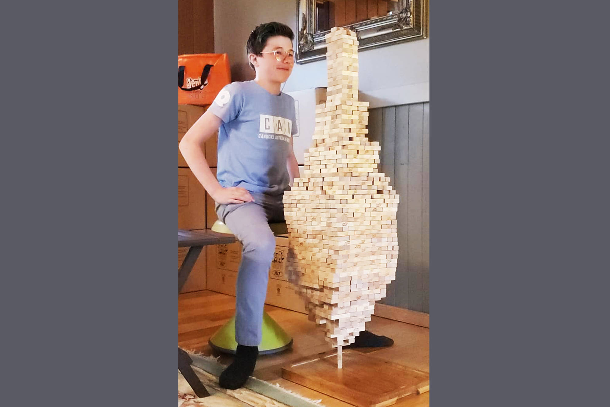 On March 27, Salmon Arm's Auldin Maxwell smashed his own Jenga stacking world record with a tower of 1,400 blocks held up by one vertical brick. (Contributed)