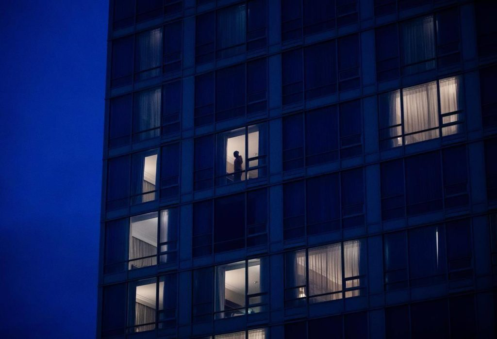 A person stands in the window in a room at a government-authorized COVID-19 quarantine hotel in Richmond, B.C. on Sunday, February 28, 2021. More than 2,000 people returning to Canada since mandatory hotel quarantines began have tested positive for COVID-19 and more than a quarter of them were infected with one of the variants of concern. THE CANADIAN PRESS/Darryl Dyck