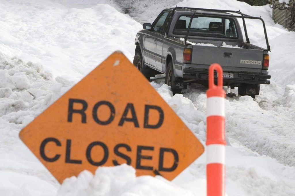 A road closed sign is placed at the bottom of a steep hill after several snow storms made some roads unuseable in North Vancouver Sunday, Dec. 28, 2008. THE CANADIAN PRESS/Jonathan Hayward
