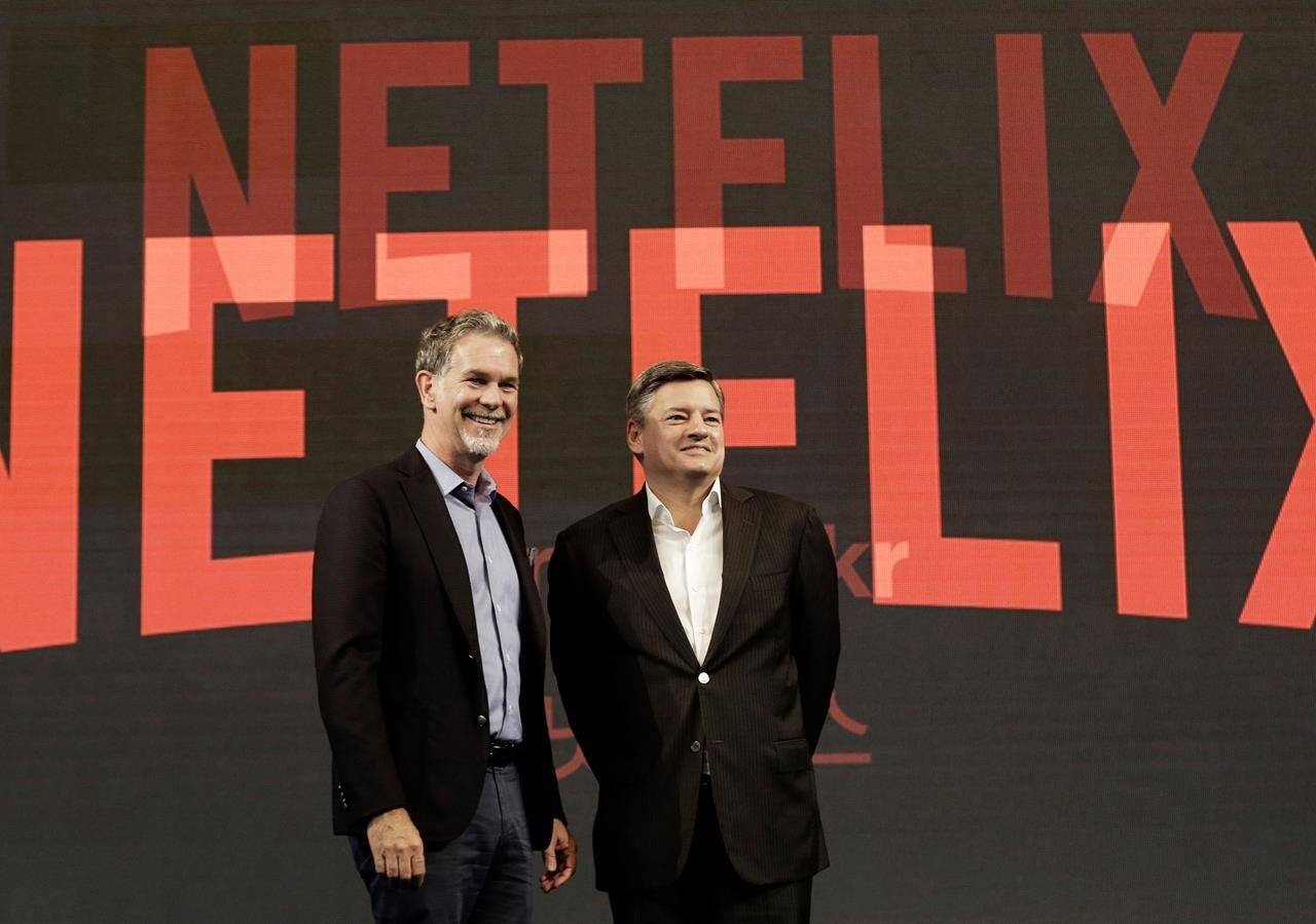 Netflix CEO Reed Hastings, left, poses with Ted Sarandos, chief content officer of Netflix, during a news conference in Seoul, South Korea. THE CANADIAN PRESS/Ahn Young-joon
