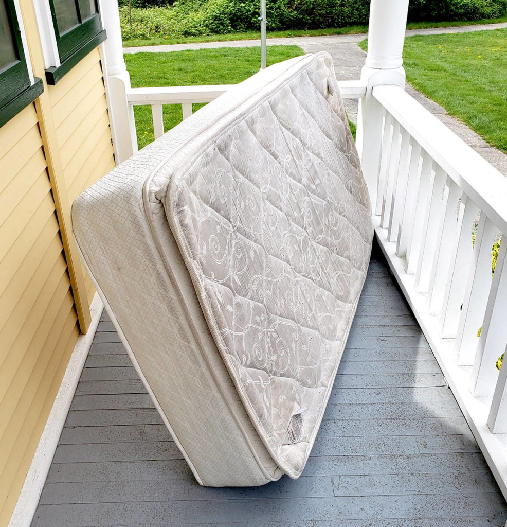 A mattress was dumped on the front porch of the Alder Grove Heritage Society. (Tami Quiring/Special to The Star)