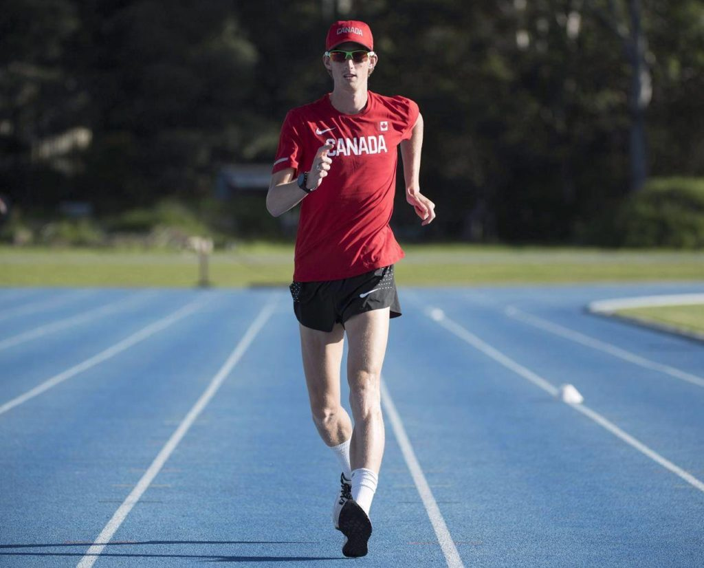 Canadian race walker Evan Dunfee, of Richmond, B.C., takes part in the team's training session for the Commonwealth Games in Gold Coast, Australia, Tuesday, April 3, 2018. THE CANADIAN PRESS/Ryan Remiorz