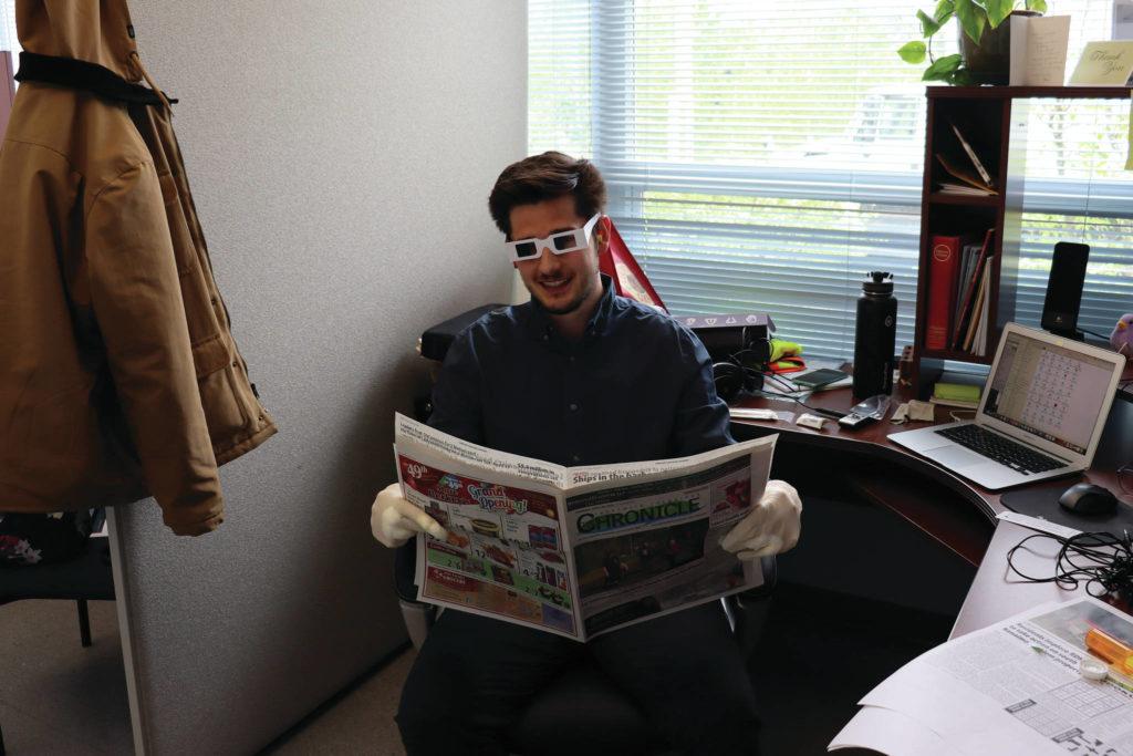 Chronicle Editor, Cole Schisler taking part in the ageing senses challenge. (Kara Olson photo)
