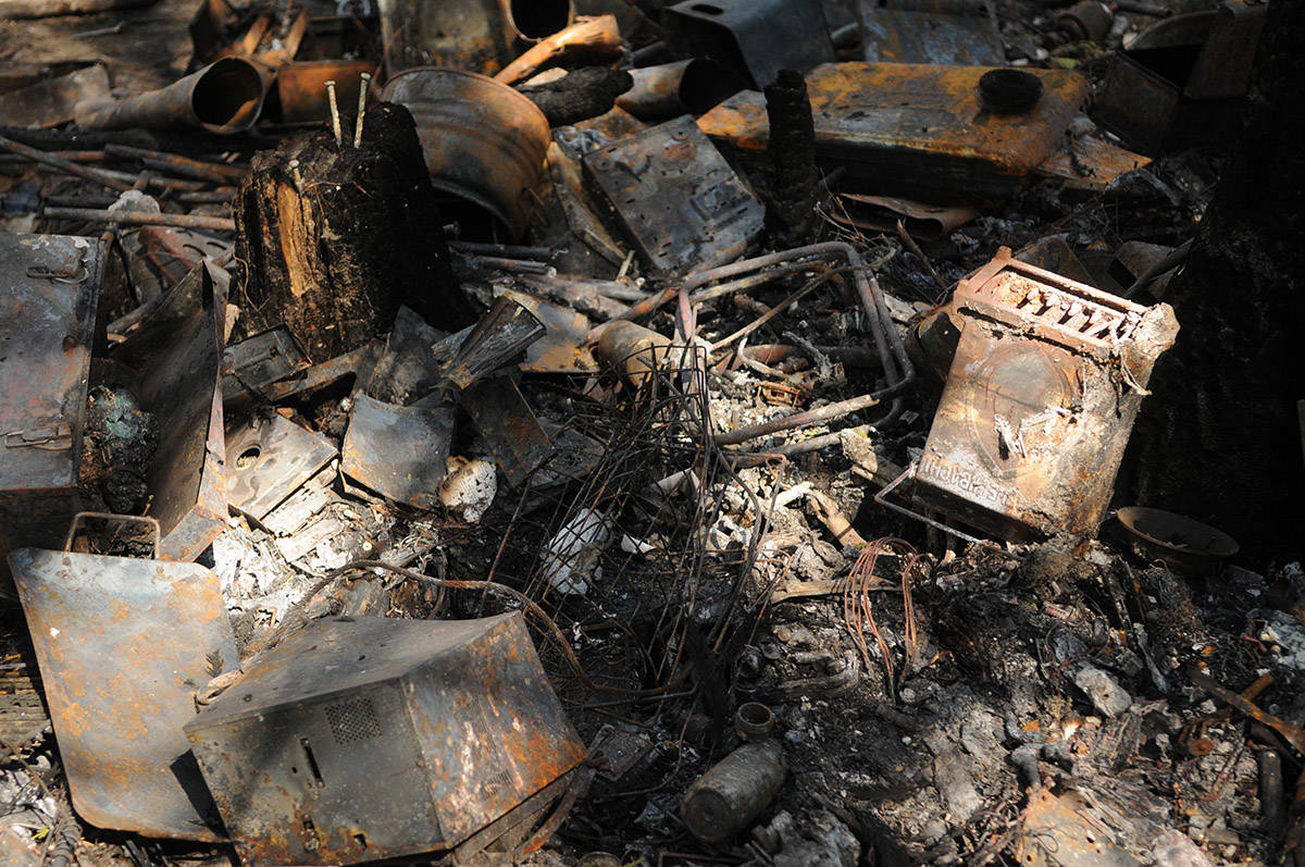 Thousands of pounds of trash was left behind following a homeless camp fire on April 9, 2021. (Jenna Hauck/ Chilliwack Progress)