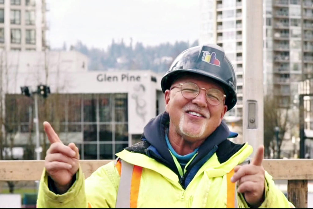 """A construction worker bursts into song on a Coquitlam job site in Langley musician Gino Gerussi's performance of """"Just In Love With A Girl"""" (Screen grab/Special to Langley Advance Times)"""