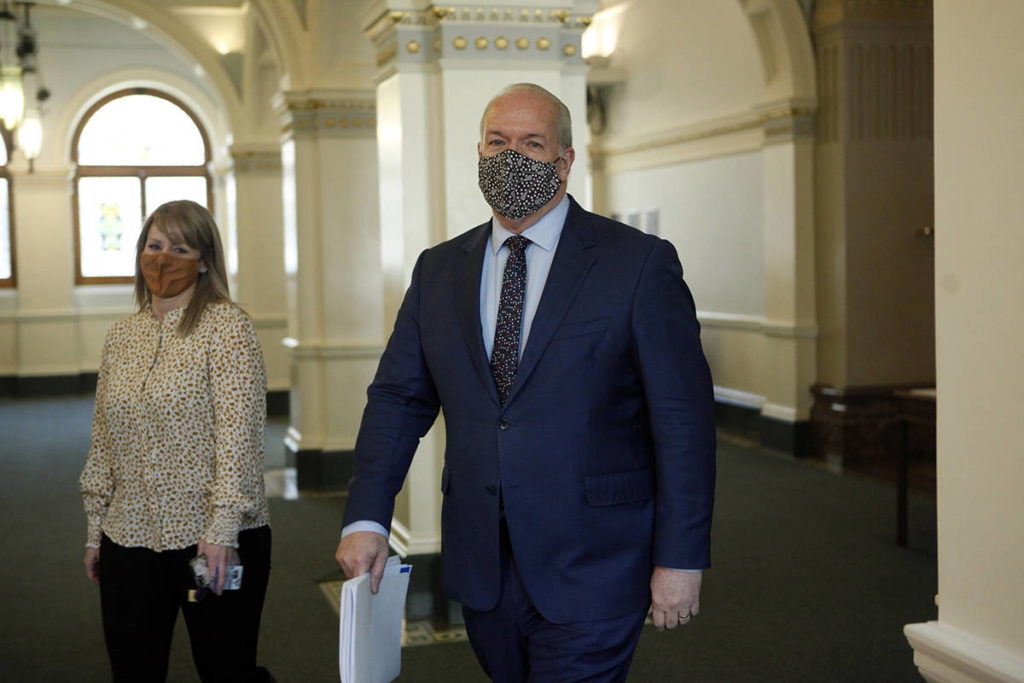 British Columbia Premier John Horgan arrives before the budget speech from the legislative assembly at Legislature in Victoria, Tuesday, April 20, 2021. THE CANADIAN PRESS/Chad Hipolito
