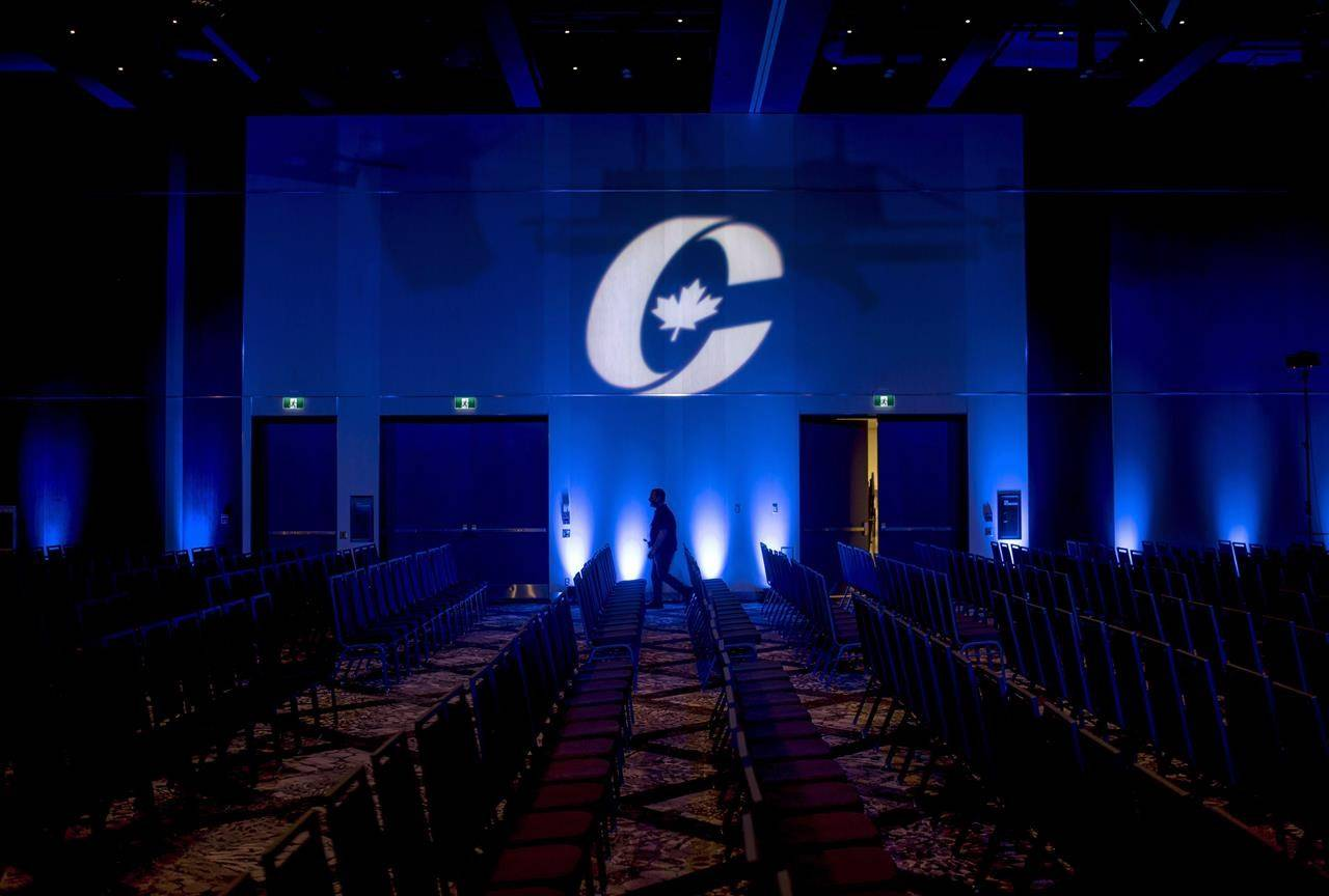 A man is silhouetted walking past a Conservative Party logo before the opening of the Party's national convention in Halifax on Thursday, Aug. 23, 2018. The Conservative Party of Canada says it raised a record $8.47 million in the first quarter of 2021. THE CANADIAN PRESS/Darren Calabrese