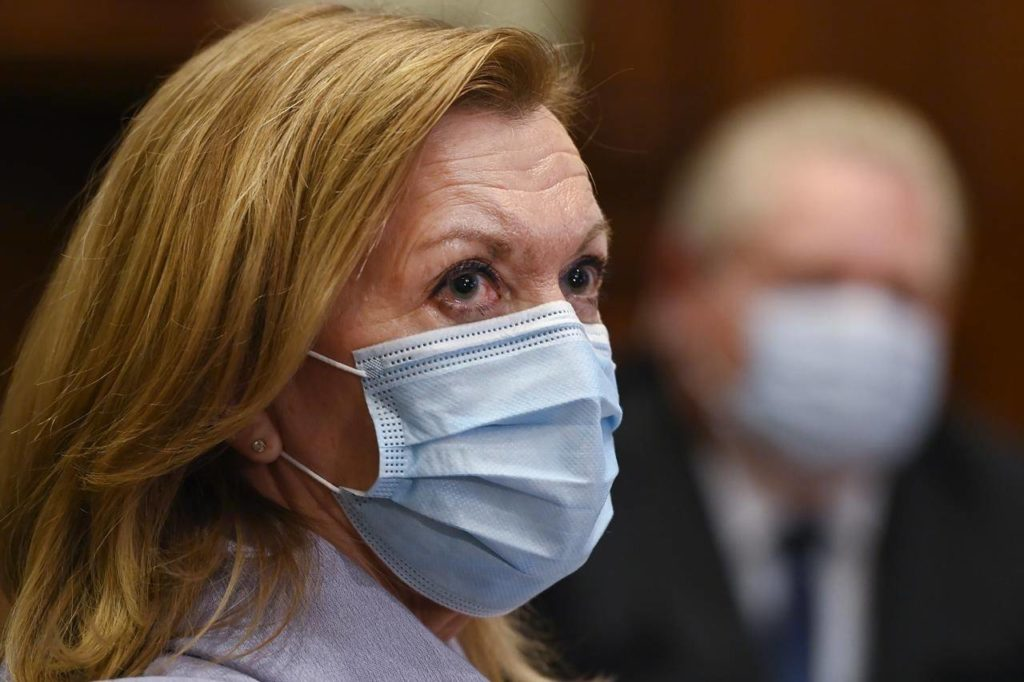 Ontario Health Minister Christine Elliott listens as Ontario Premier Doug Ford gives an update regarding the Ontario COVID-19 vaccine in Toronto on Tuesday, January 5, 2021. Ontario says hospitals will be able to transfer patients waiting for a long-term care bed to any nursing home without their consent in an effort to free up space. THE CANADIAN PRESS/Nathan Denette