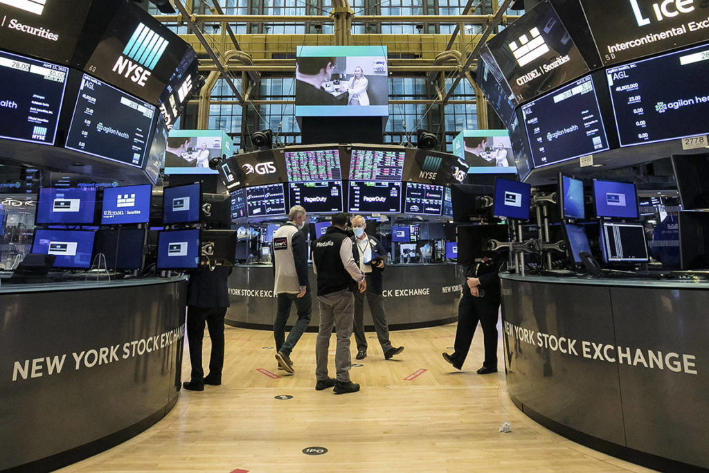 In this photo provided by the New York Stock Exchange, traders work on the floor, Thursday, April 15, 2021.(Courtney Crow/New York Stock Exchange via AP)