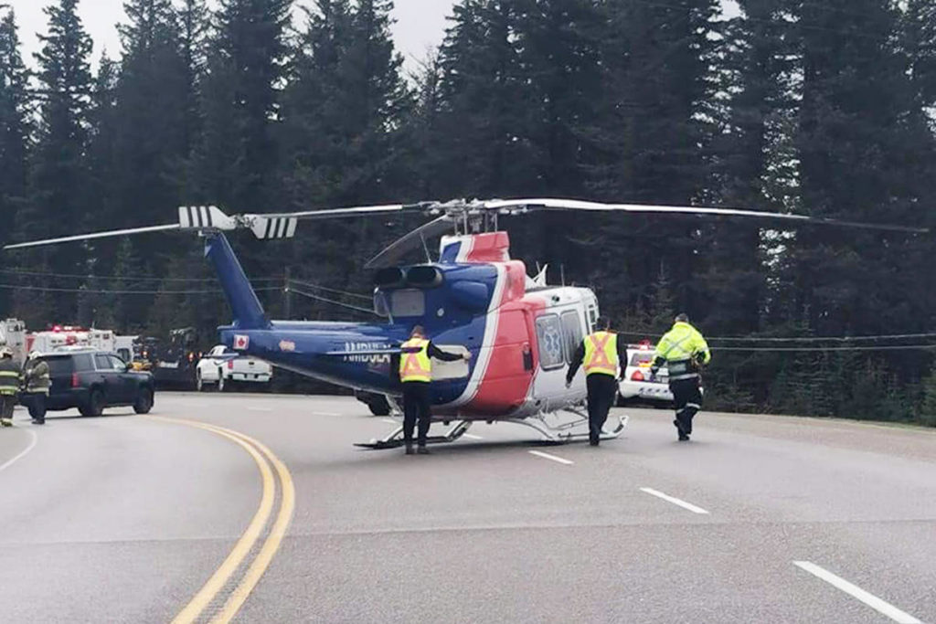 Emergency services attend the scene of a collision just north of Hixon Thursday morning, April 29, which has closed Highway 97. (Mary Sword photo)