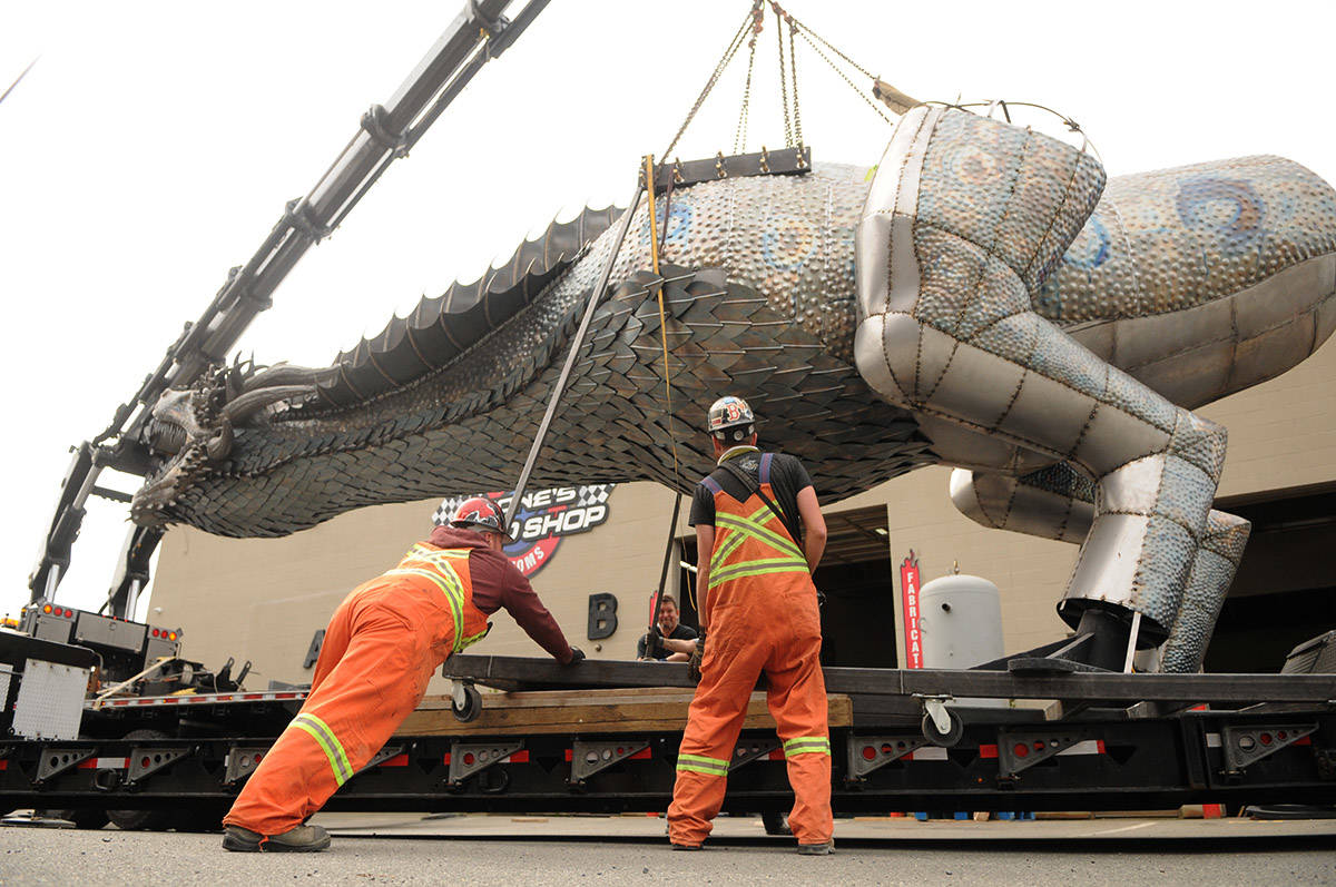 Crews prepare to move Kevin Stone's 8,000-pound unfinished steel dragon from Stone's Speed Shop to a new location in Yarrow on Thursday, April 29, 2021 (Jenna Hauck/ Chilliwack Progress)