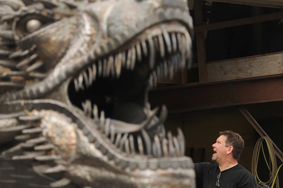 Kevin Stone helps move his 8,000-pound unfinished steel dragon from Stone's Speed Shop to a new location in Yarrow on Thursday, April 29, 2021 (Jenna Hauck/ Chilliwack Progress)