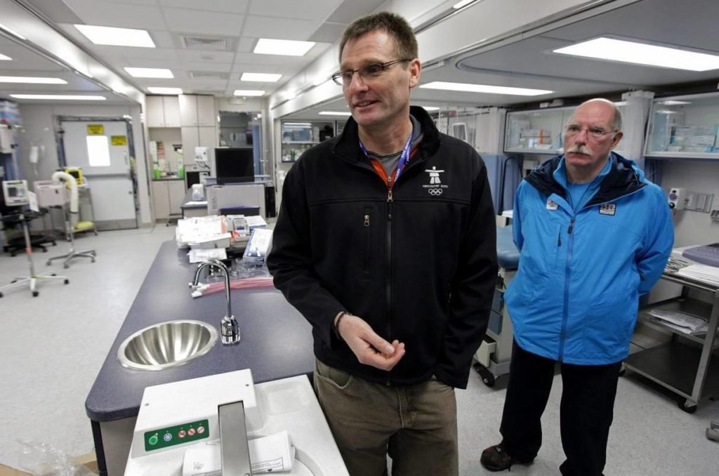 Director of medical services for VANOC, Dr. Mike Wilkinson, left, and mobile unit manager Dr. Ross Brown speak to reporters in a mobile medical unit set up for the Vancouver 2010 Winter Olympic Games in Whistler, B.C., on Wednesday, January 20, 2010. Wilkinson is confident that with the pace of the country's vaccine rollout, every Canadian athlete will be vaccinated before this summer's Tokyo Olympics. THE CANADIAN PRESS/Darryl Dyck