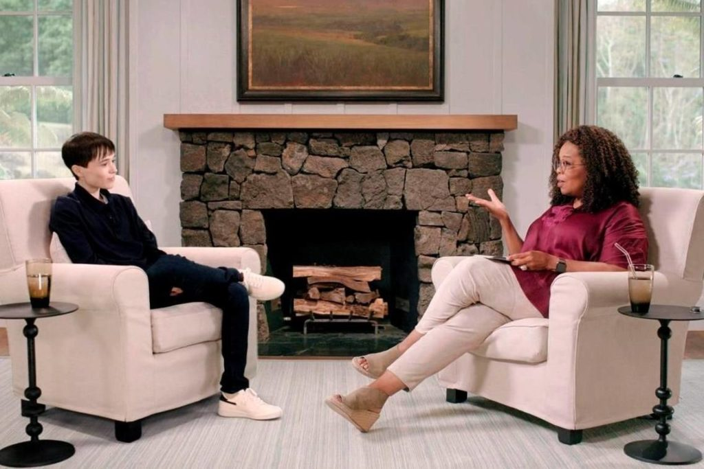 """This image released by Apple TV+ shows Elliot Page, left, with Oprah Winfrey during an episode of """"The Oprah Conversation,"""" an interview series on Apple TV+. Page is revealing how happier he feels after having top surgery and how important he believes it is to support health care for transgender people. (Apple TV+ via AP)"""