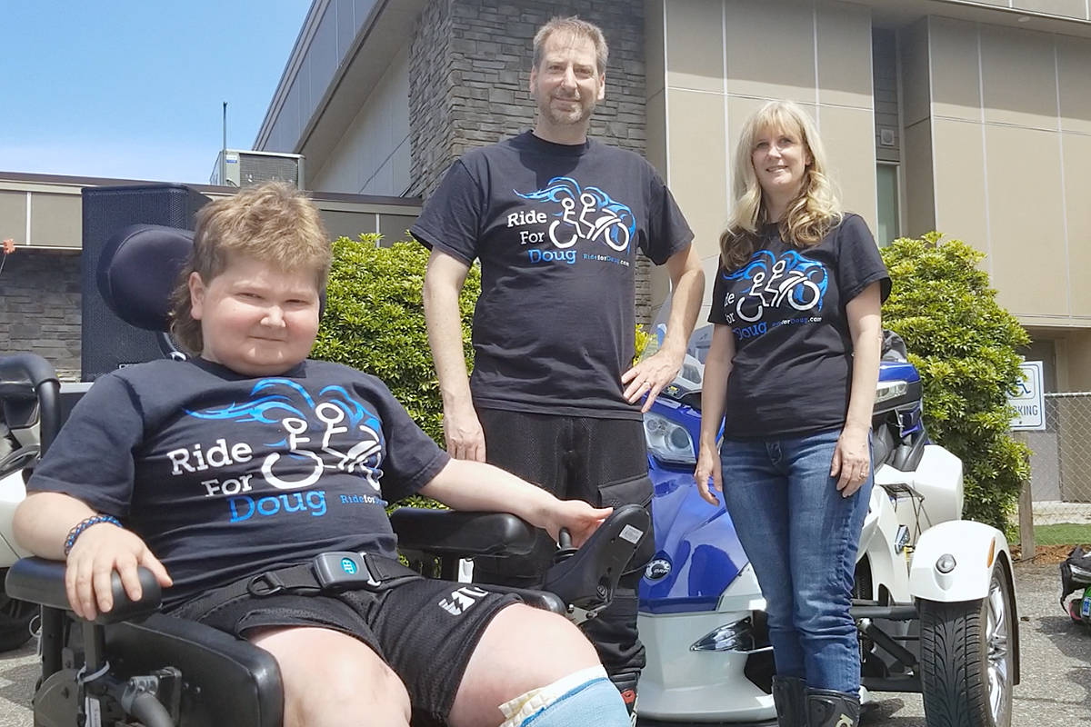 Doug Penner, with dad Cam and mom Allison, just before the ride got underway. Dan Ferguson Langley Advance Times