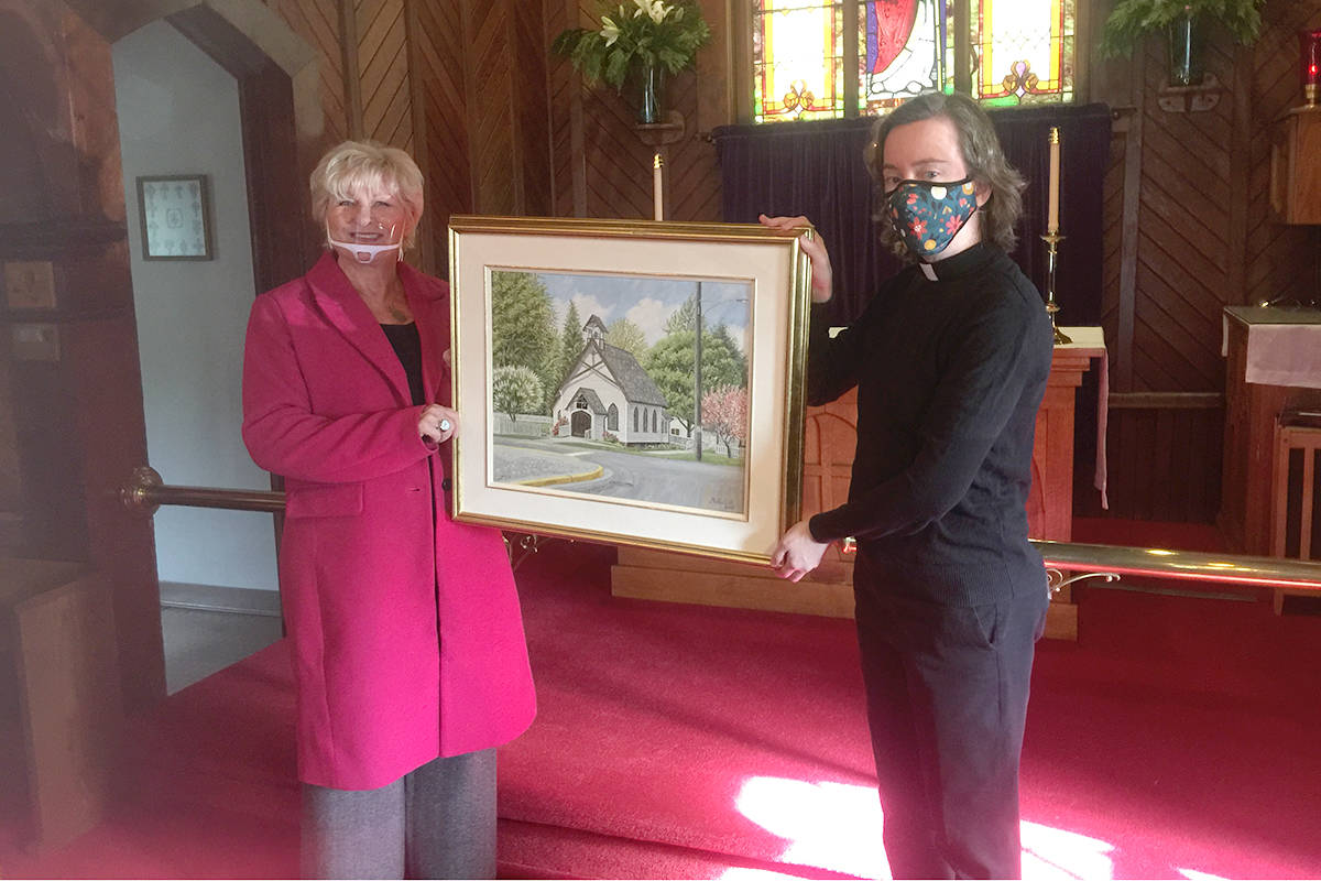 Norma Morosan (left), wife of artist Vojislav Morosan has donated her late husband's painting – 'Anglican Church' – to St. George's Anglican Church in Fort Langley. The donation was accepted by Rev. Kelly Duncan. (Roy Cline/Special to Langley Advance Times)