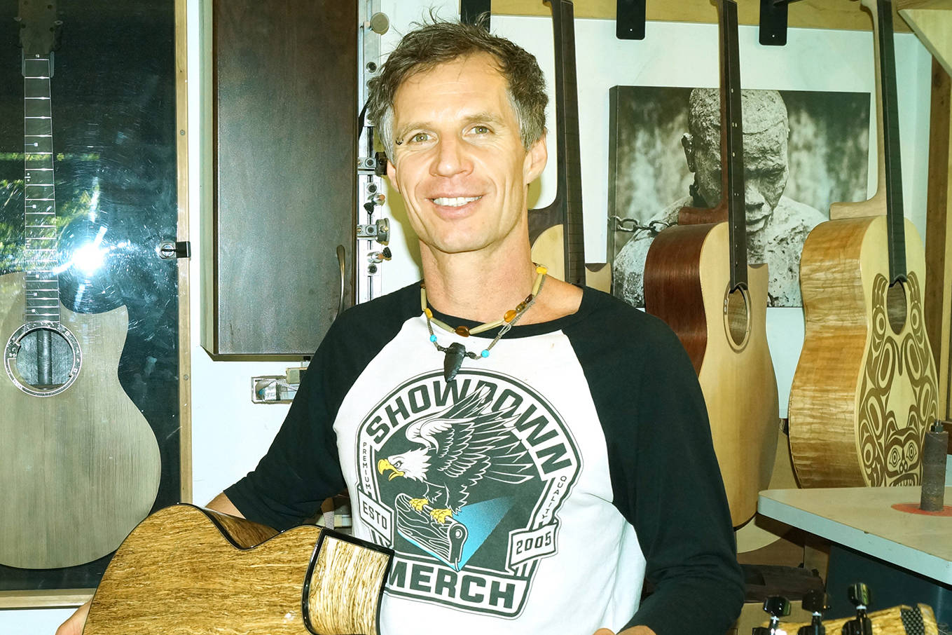 Reuben Forsland in his East Sooke studio with the guitar he crafted from hemp wood that he hopes will start a conversation about sustainability. (Rick Stiebel - Sooke News Mirror)