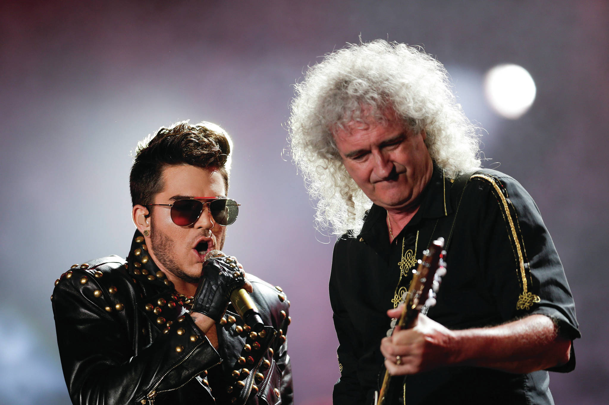 In this Sept. 19, 2015 file photo Adam Lambert, left, and Brian May of Queen perform at the Rock in Rio music festival in Rio de Janeiro, Brazil. May has also earned his PhD. (AP Photo/Felipe Dana, File)