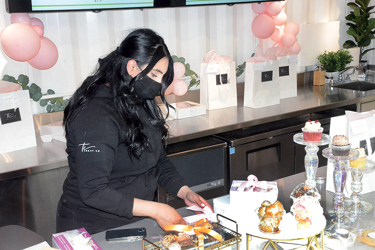 Gabby Gill worked at Treat Co's pop up store in the Willowbrook Shopping Centre's Willow Way on Friday, April 30. (Matthew Claxton/Langley Advance Times)