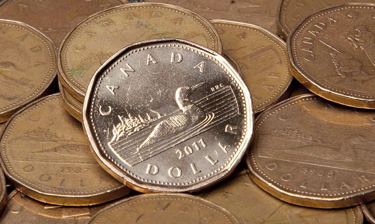 Economists say the Canadian dollar is at a 'sweet-spot' after hitting a three-year-high yesterday, reaching a point where it benefits consumers but doesn't hurt businesses too much. THE CANADIAN PRESS/Jonathan Hayward