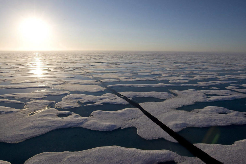The midnight sun shines over the ice-covered waters near Resolute Bay at 1:30 am as seen from the Canadian Coast Guard icebreaker Louis S. St-Laurent Saturday, July 12, 2008. THE CANADIAN PRESS/Jonathan Hayward