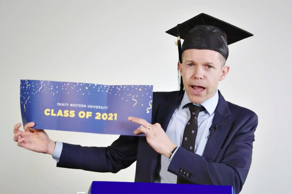 "TWU Senior Vice President of Enrolment, Personal and Professional Development Brian Kerr, opened the Langley university's virtual grad event on Saturday, May 1, with an ""unboxing"" of the celebration box that every graduate received by mail. (Special to Langley Advance Times)"