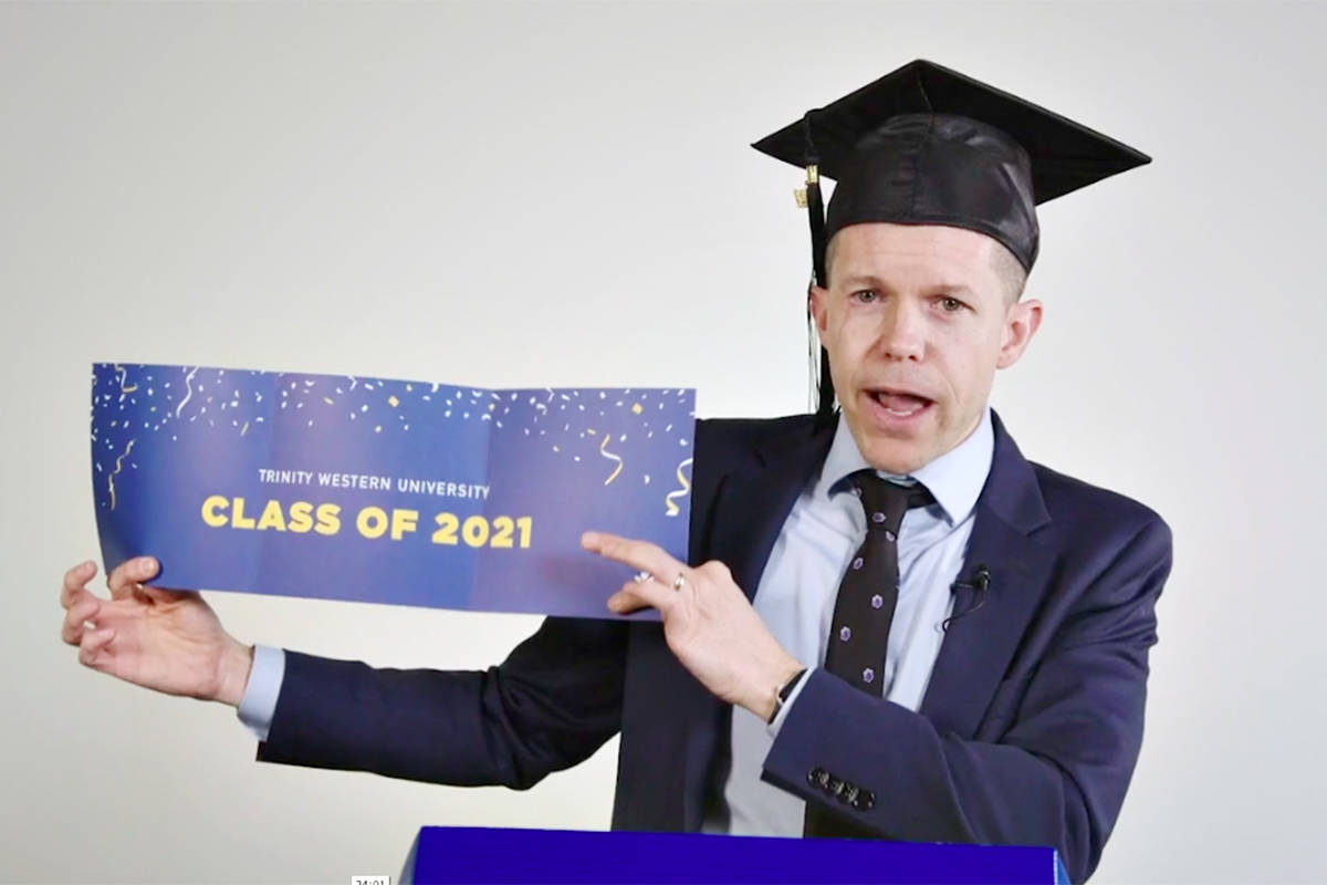 """TWU Senior Vice President of Enrolment, Personal and Professional Development Brian Kerr, opened the Langley university's virtual grad event on Saturday, May 1, with an """"unboxing"""" of the celebration box that every graduate received by mail. (Special to Langley Advance Times)"""