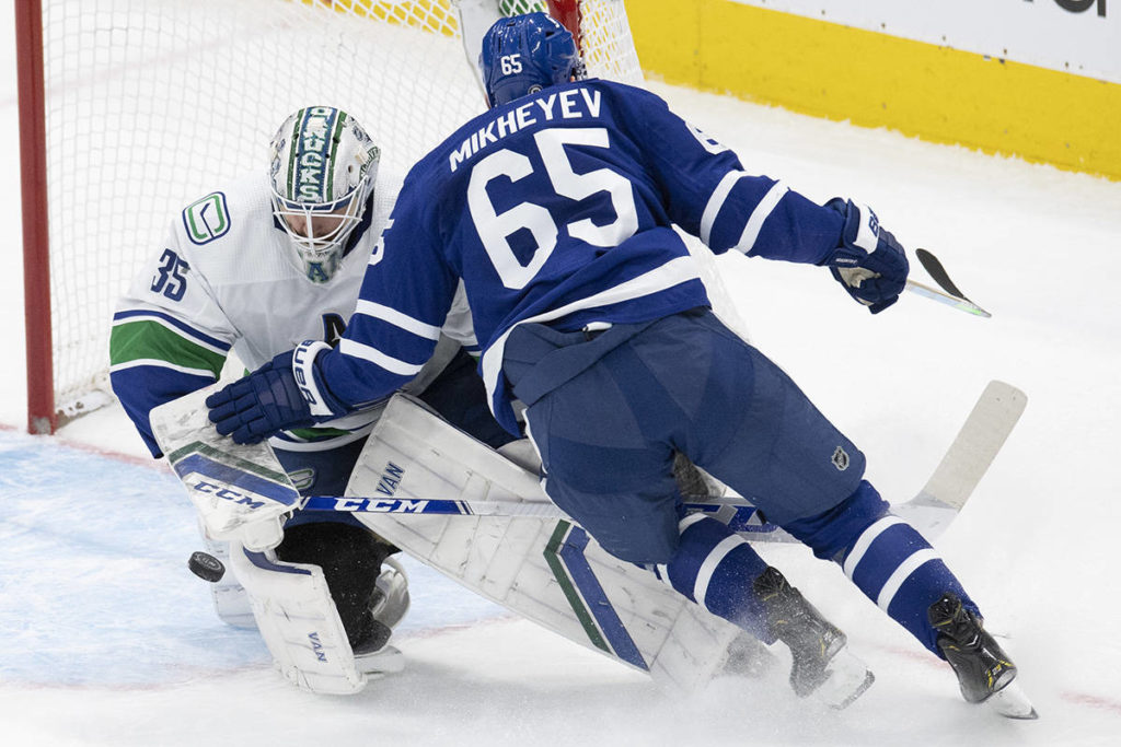Toronto Maple Leafs right wing Ilya Mikheyev (65) collides with Vancouver Canucks goaltender Thatcher Demko (35) on a breakaway during second period NHL action in Toronto on Saturday May 1, 2021. THE CANADIAN PRESS/Frank Gunn
