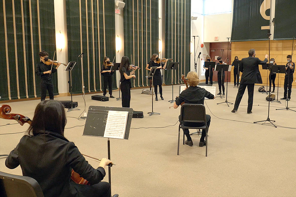 Langley Community Music School's orchestra performed, with students joining both in-person and virtually, to meet COVID guidelines. (Screengrab/Special to Langley Advance Times)