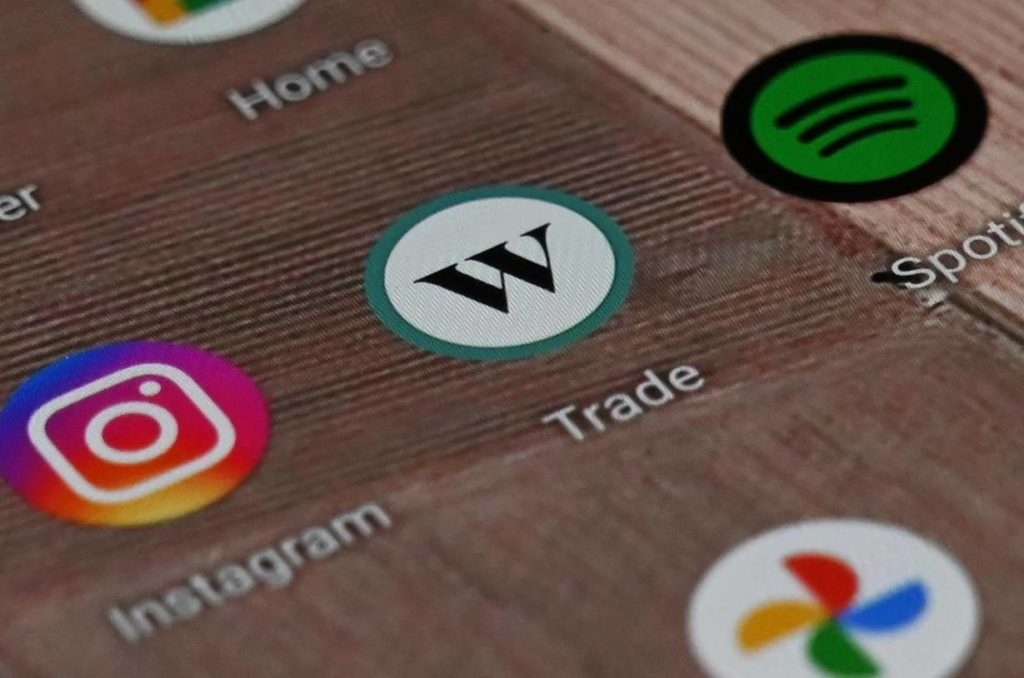 A Wealthsimple Trade app icon is shown on a smartphone on Tuesday, Dec. 15, 2020. THE CANADIAN PRESS/Jesse Johnston