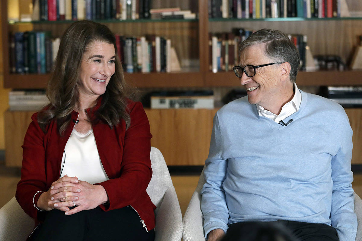 FILE - In this Feb. 1, 2019, file photo, Bill and Melinda Gates look toward each other and smile while being interviewed in Kirkland, Wash. The George W. Bush Presidential Center is honoring the Gates with its annual award for those who work to improve the lives of others. Former President George W. Bush and former first lady Laura Bush on Thursday, April 11, will present the Gates with the George W. Bush Medal for Distinguished Leadership. (AP Photo/Elaine Thompson, File)
