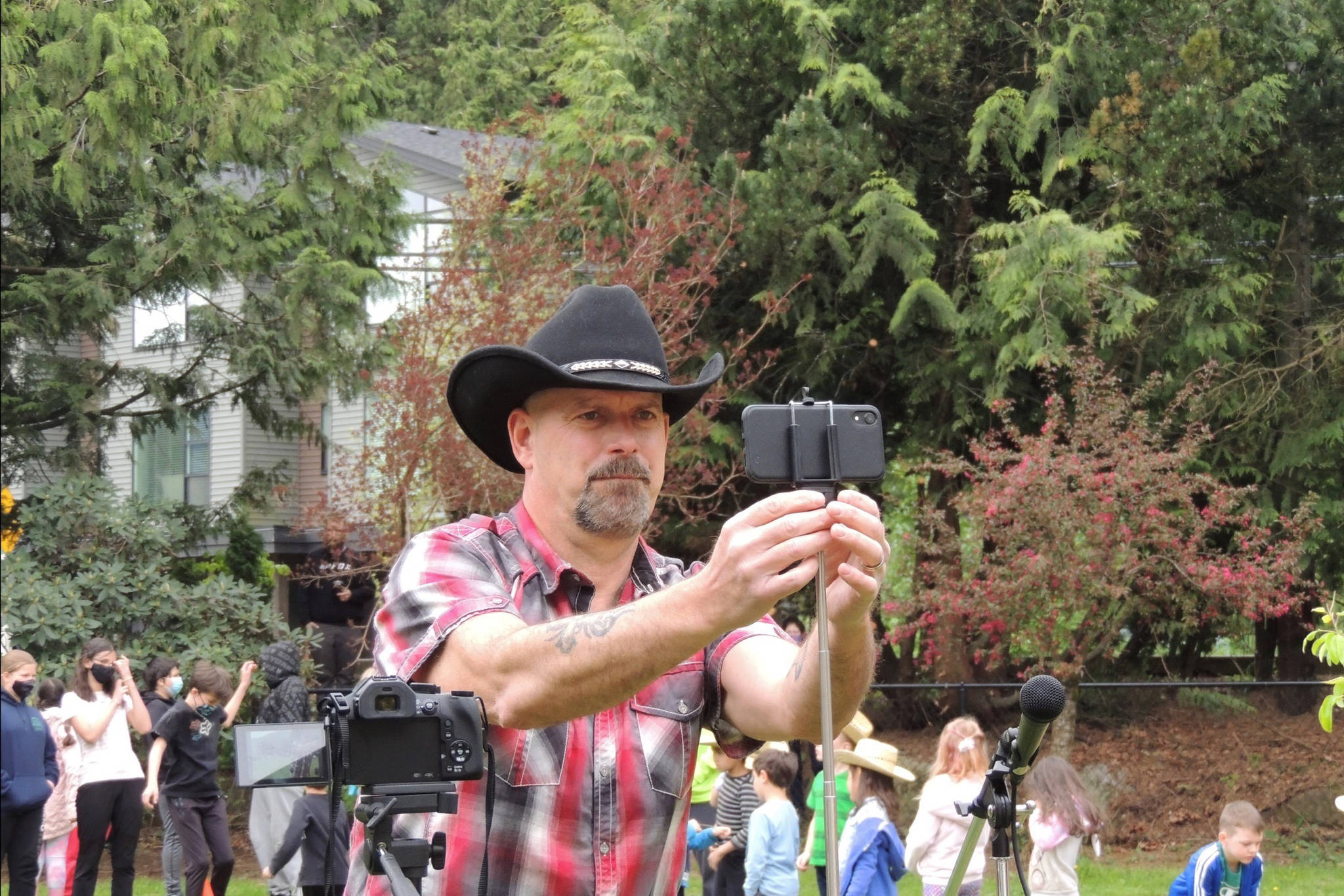 "Harrison country artist Todd Richard adjusts his camera before filming ""Green and Blue"" as sung by he and the students of Harrison Hot Springs Elementary. (Adam Louis/Observer)"