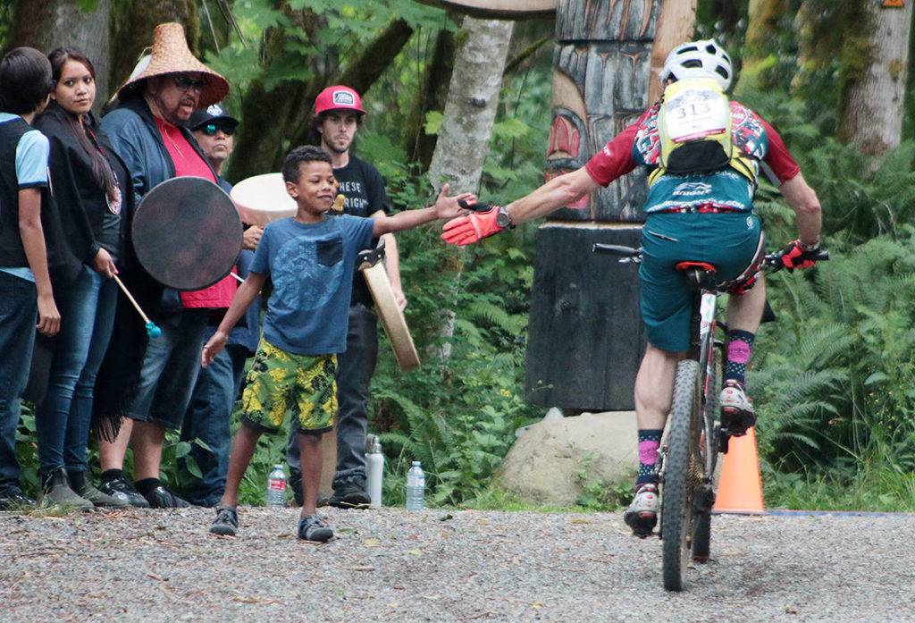 Justin Jack-Thomas congratulates a competitor in the BC Bike Race for finishing the first part of the Cowichan Valley stage in 2018. (Black Press Media file)