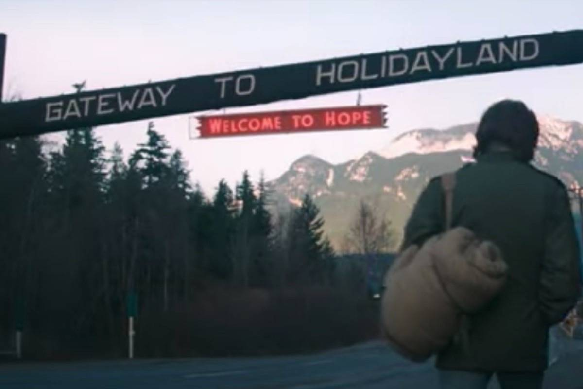 The 'Gateway to Holidayland' sign in the Rambo franchise' first film, First Blood. (Youtube screenshot)