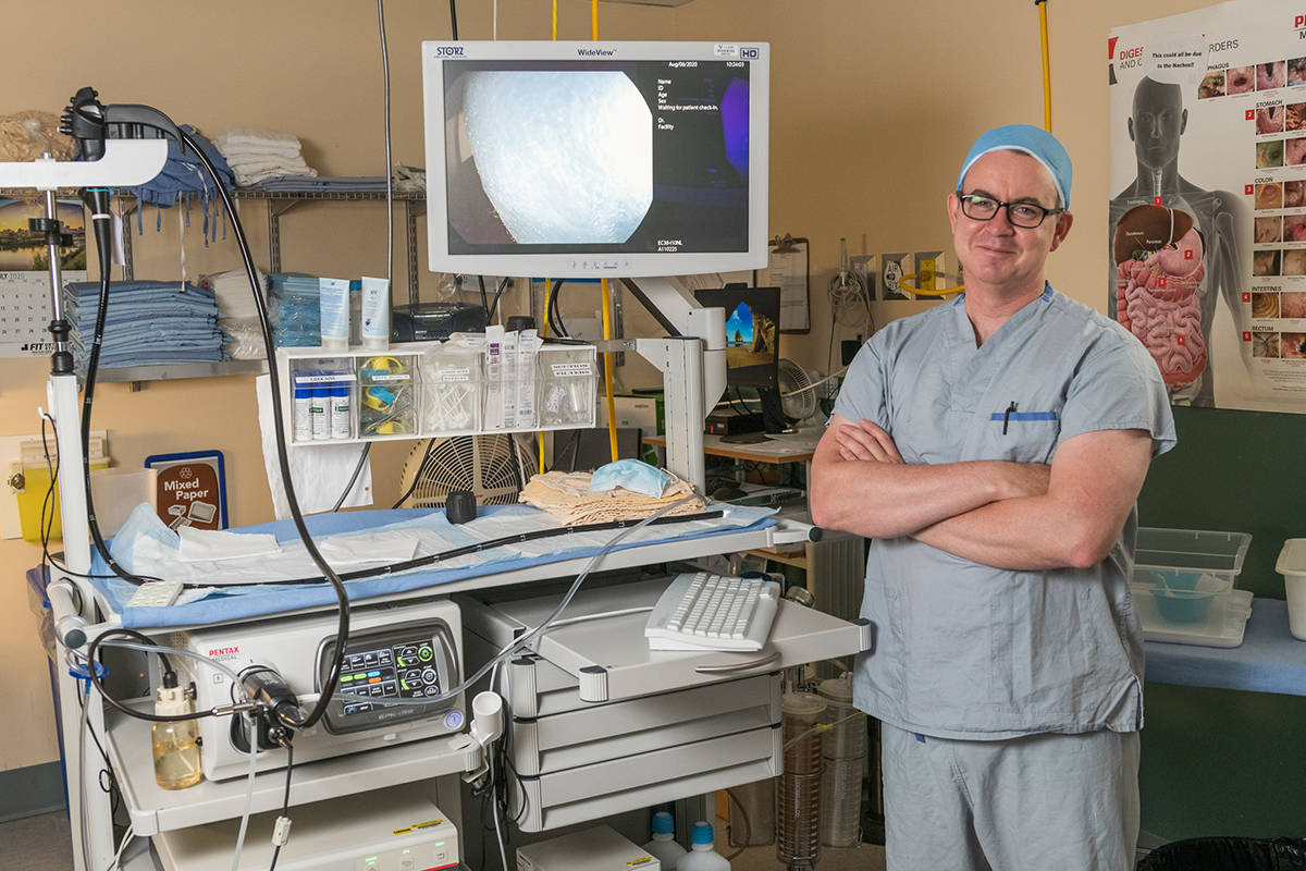 Langley Memorial Hospital surgeon Dr. Scott Cowie, with a donor-funded video processing machine used for day surgeries.