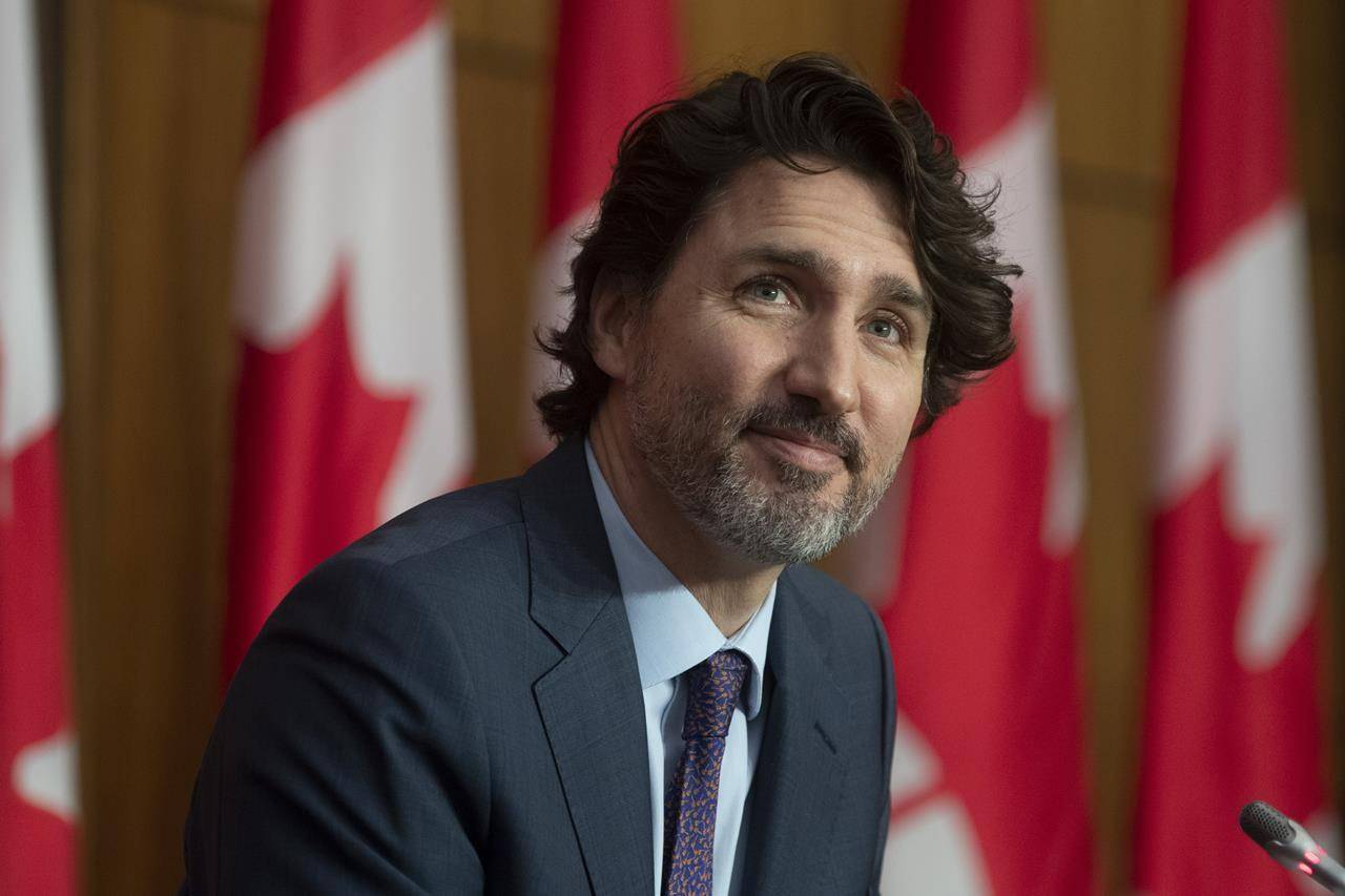 Prime Minister Justin Trudeau listens to speakers appearing by video during a news conference in Ottawa on Tuesday May 4, 2021. THE CANADIAN PRESS/Adrian Wyld
