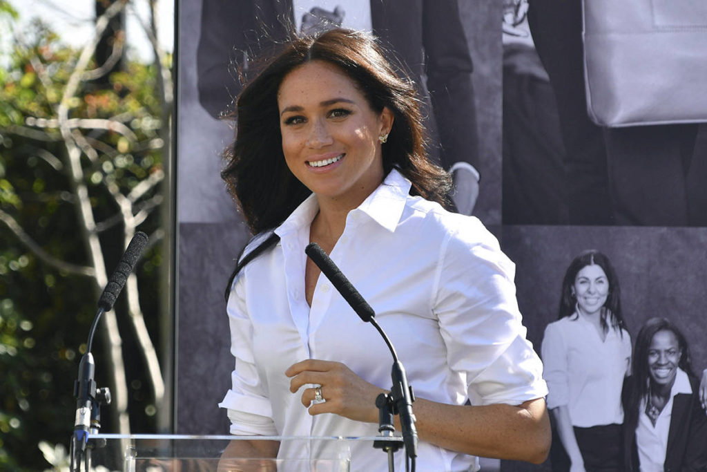 FILE - In this Thursday, Sept. 12, 2019 file photo, Britain's Meghan, Duchess of Sussex launches the Smart Works capsule collection at John Lewis in Oxford Street. (Mark Large/Pool via AP, File)