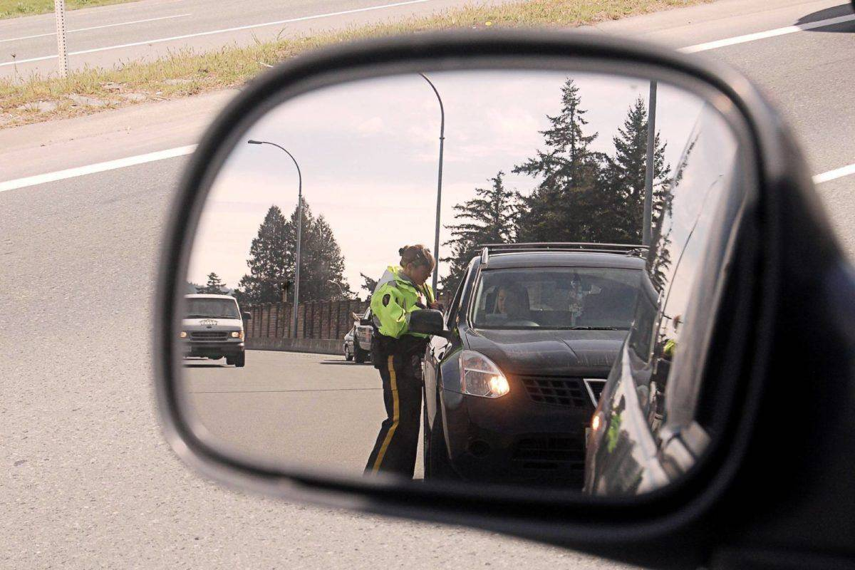 RCMP officers and Delta and West Vancouver forces are conducting road checks for non-essential travel on highways and ferries in and out of B.C.'s Lower Mainland as part of COVID-19 public health . (Black Press file photo)