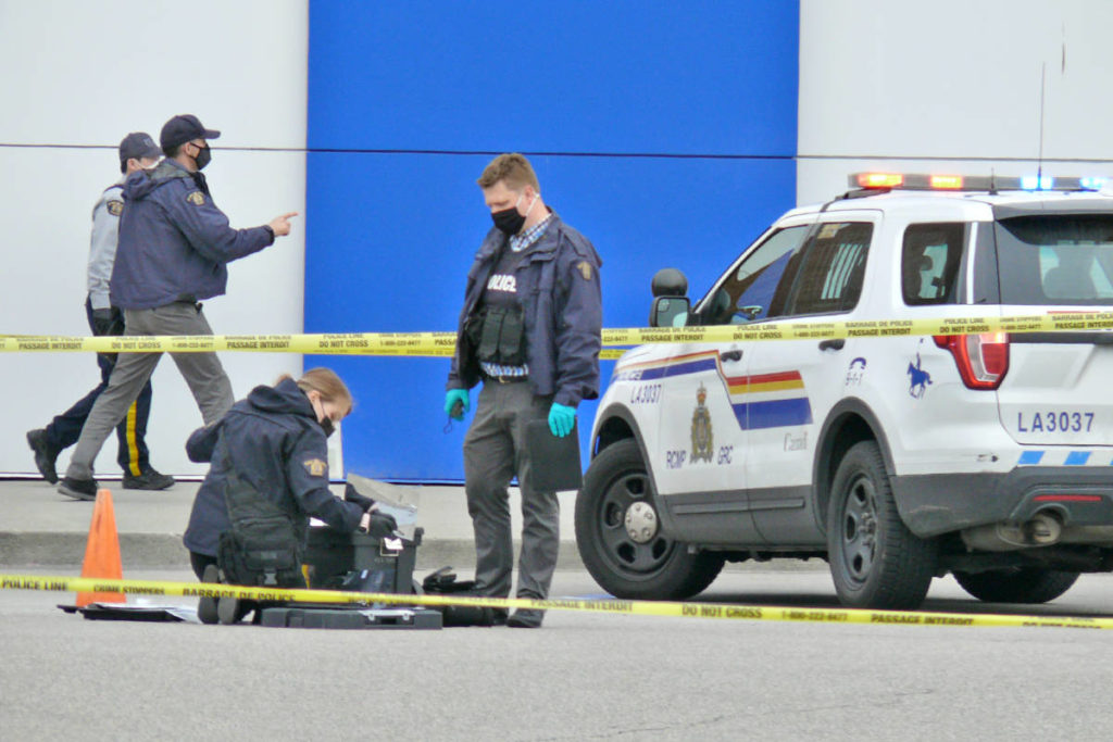 Police examined the scene following a shooting incident at Willowbrook Shopping Centre in Langley that seriously injured one man. (Dan Ferguson/Langley Advance Times)