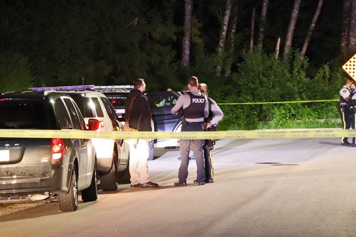 Surrey RCMP officers on scene at a shooting in the 9700-block of 161A Street Tuesday, May 4, 2021. A woman was found suffering from a gunshot wound and taken to hospital, while a man was taken into custody. (Photo: Shane MacKichan)