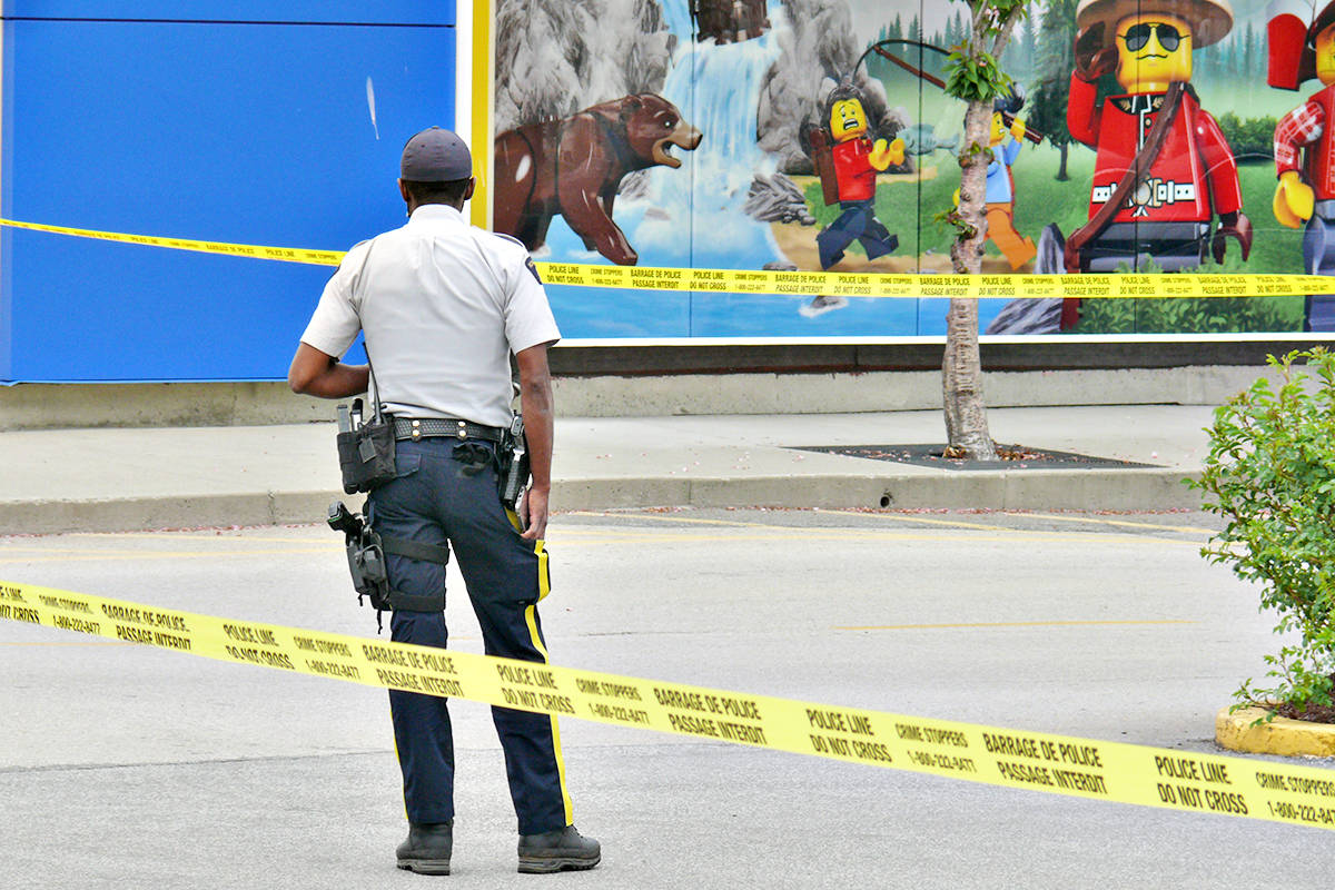 An RCMP officer at the scene of the Monday, May 3, shooting outside the Toys 'R' Us store in the Willowbrook Shopping Centre parking lot. (Dan Ferguson/Langley Advance Times)