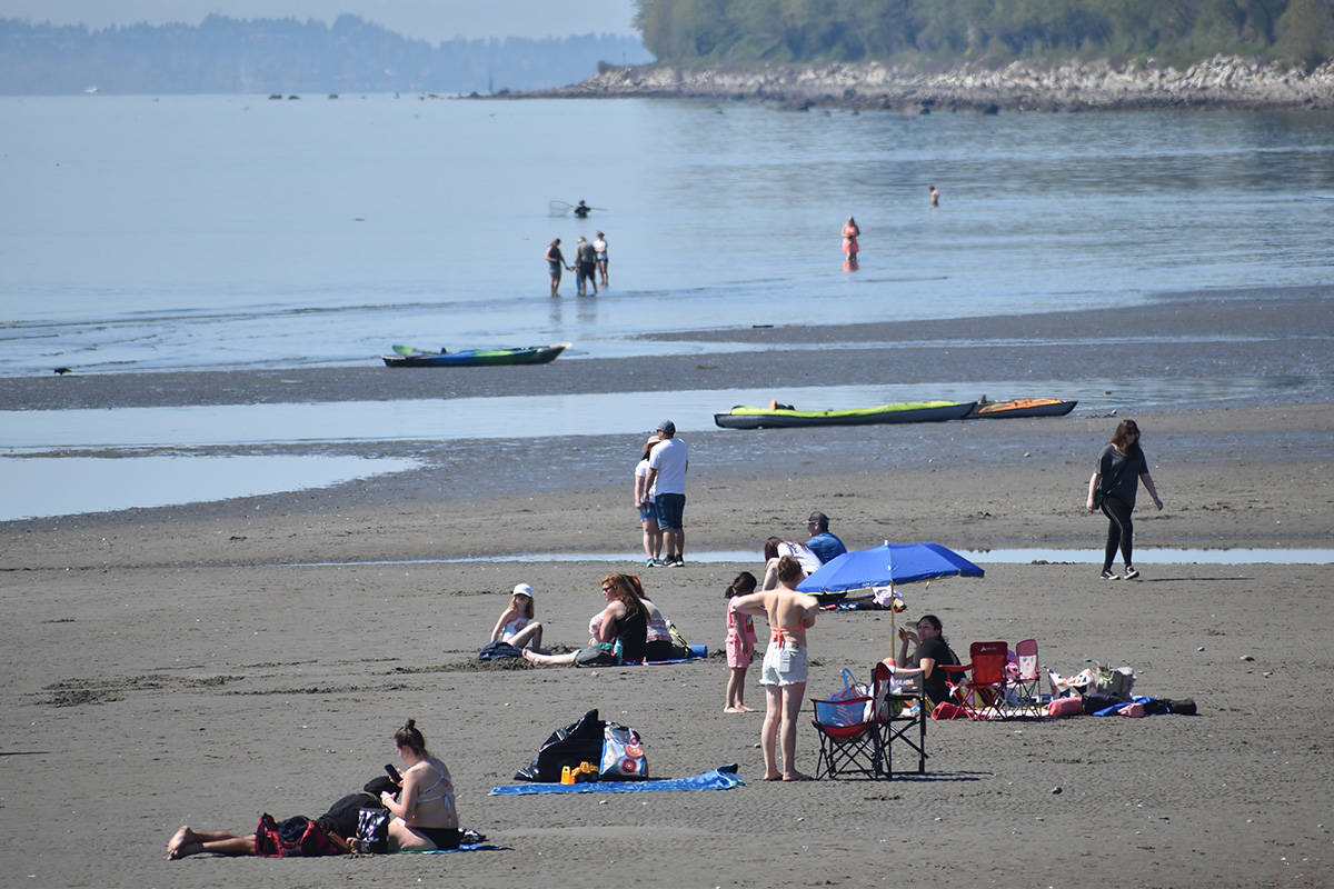 Low tide offered plenty of space for people to relax on White Rock's beach Sunday afternoon. (Aaron Hinks photo)