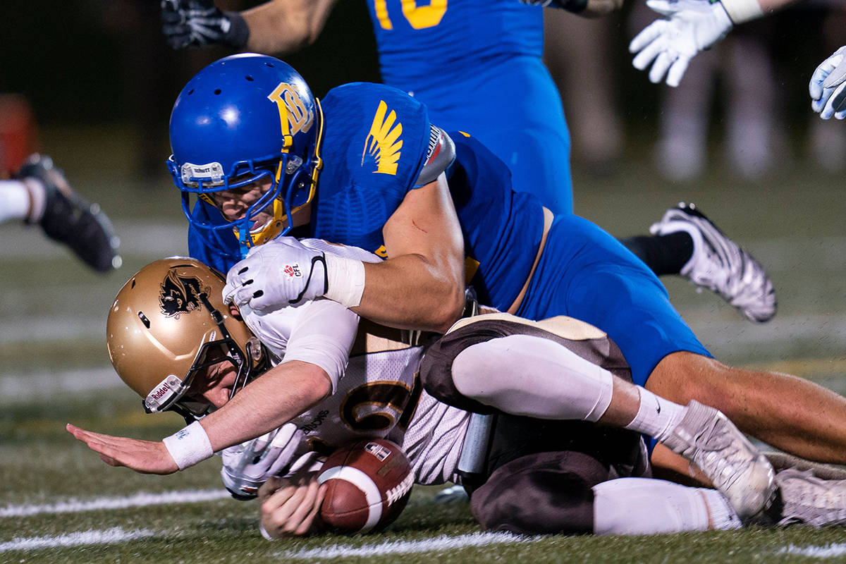 Former Vernon Panthers football standout Ben Hladik of the UBC Thunderbirds (top, in a game against the Manitoba Bisons, <ins>making one of his 38 Canada West solo tackles in 2019</ins>), was chosen in Tuesday's 2021 Canadian Football League draft. (Rich Lam - UBC Thunderbirds photo)