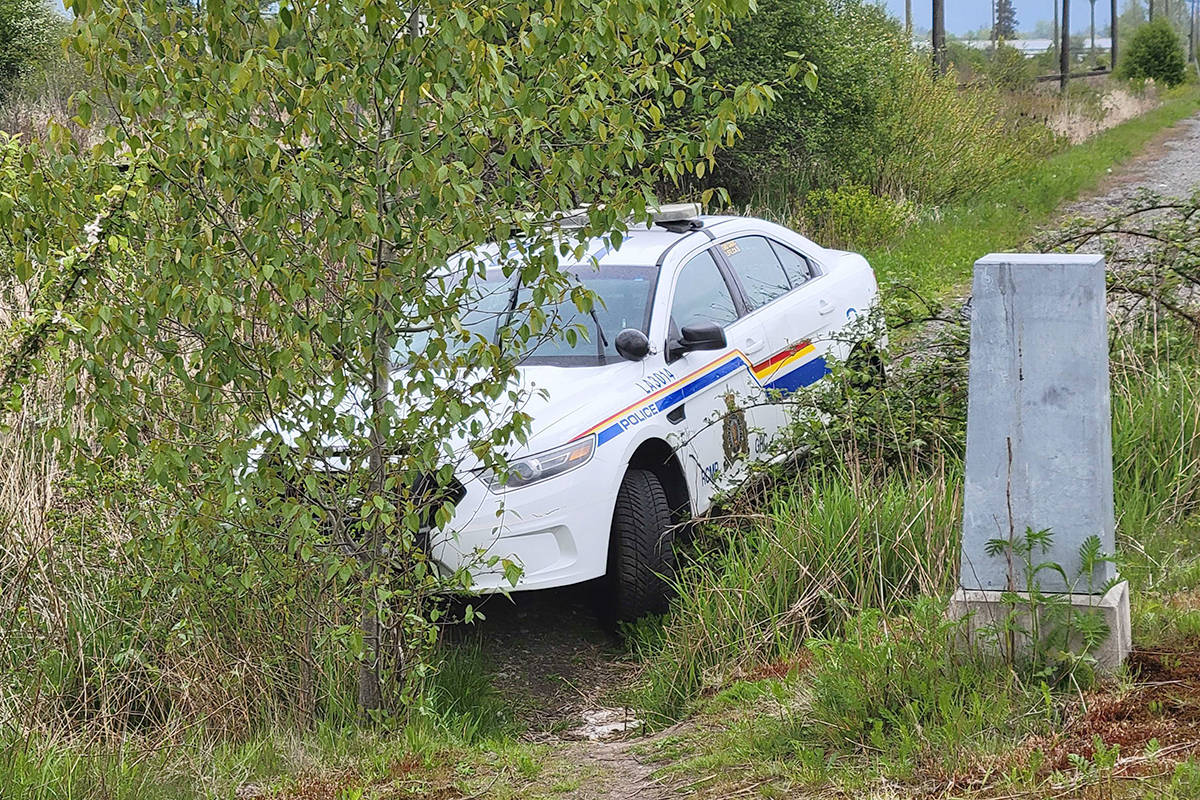 An RCMP cruiser ended up in a ditch near the Mufford Overpass midday Monday, May 3, 2021 after a couple tried to evade arrest by stealing it. (Dan Ferguson/Langley Advance Times)