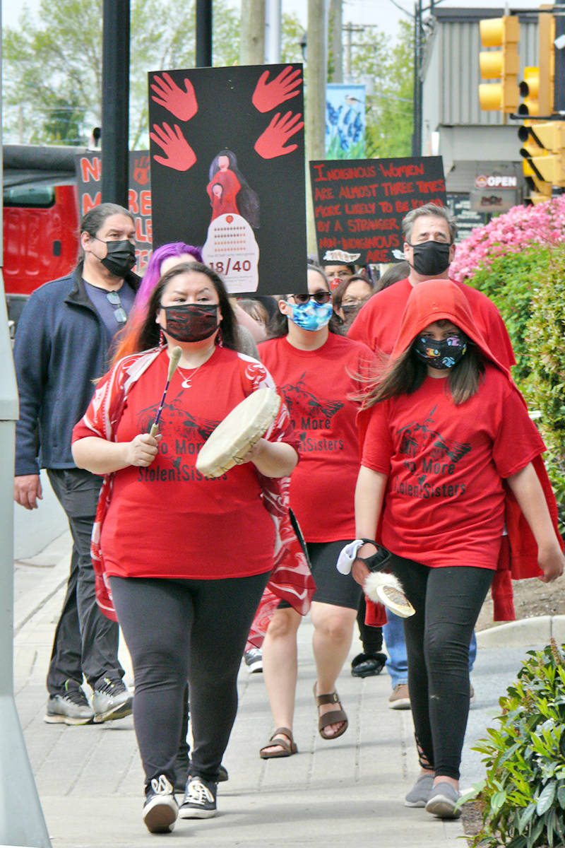 About 60 people took part in a Wednesday march through Langley City, marking Red Dress Day, a day to remember missing and murdered Indigenous women. (Dan Ferguson/Langley Advance Times)